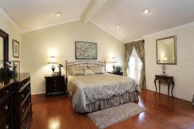 bedroom designed with light wall colors and vaulted ceiling featured recessed lights vaulted ceiling lighting
