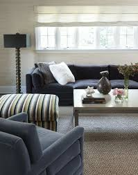 sisal rugs with contemporary living room and black sofa black table lamp blue armchair chunky knit pillow grass cloth wallpaper light coffee table