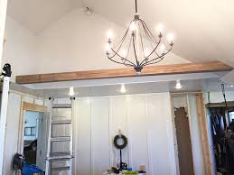 look at these amazing faux wood beams that we installed in our bedroom