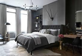 grey mens bedroom. Wonderful Grey Masculine Bedroom Features Walls Clad In Dark Grey Grasscloth Wallpaper  Accented With Antlers Over  For Grey Mens Bedroom 2