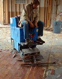 how to remove glued hardwood floor from concrete
