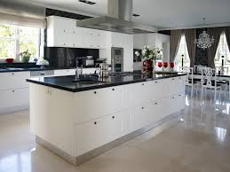 a kitchen of contrasts holds this large island in black and white replete with expansive