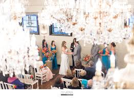 gorgeous chandelier barn for wedding ceremony