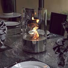 view in gallery small portable fireplace in modern glass cylinder