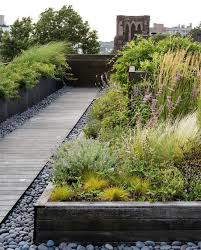a wooden walkway feels like summer underfoot whether it s a beach boardwalk or a rollout garden path with inspiration from an ipe walkway that designer