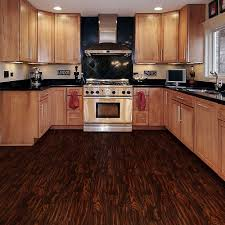 oak kitchen cabinets with cooper range hoods and dark empire oak vinyl plank flooring