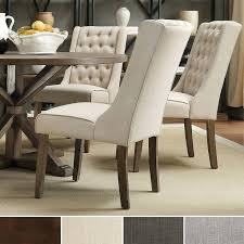 wingback dining room chairs best have a seat images on upholstered tufted dining chairs high wing