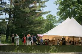 enjoyed the weather while others under the tent partited in the silent art auction contributed photo by neil landino new canaan the glass house