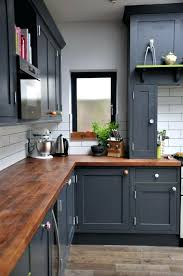 dark grey cabinets rich wood counter tops white subway tile kitchen cabinet refinishing calgary ab