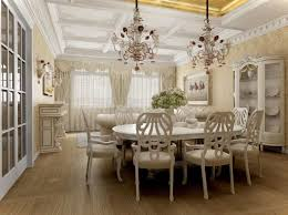traditional dining room lighting idea with double classic crystal chandelier over white dining set and