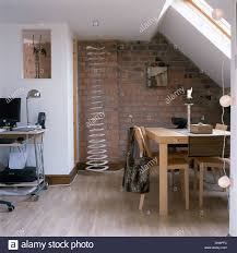 Against The Wall Dining Table Pale Wood Table And Chairs In Dining Area Of Small Loft Conversion