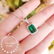 halo emerald cut emerald pendant muzo