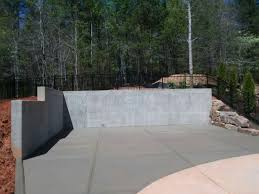 poured concrete is an excellent choice for retaining wall material due to its strength and durability concrete naturally is water resistant and does not
