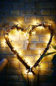 balcony lighting. willow heart wrapped with string and a skruv led lighting chain balcony