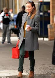 Autumn chic: Olivia Wilde looked classy in her smart grey coat, mustard  sweater and