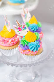 Unicorn Cupcakes With Multicolor Buttercream Icing On Cake Stands