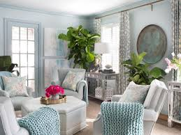 pretty living room decorations light blue walls light grey chairs framed glass door patterned curtains