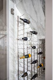 small wine cellar under stairs with marble walls