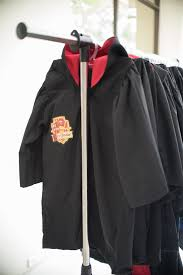 gryffindor house robes from a honeydukes hogwarts harry birthday party via kara s party ideas