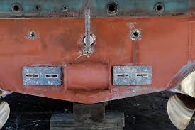 bow thrusters are usually mounted in a structural fibergl in the bow of a boat