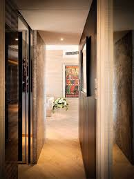 interior: Chic Uplight On Wooden Floor Closed Nice Door Fit To Hallway  Designs With White