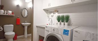 laundry room furniture. Wash Room With Washer-dryer Combo, Toilet And Vanity Laundry Furniture