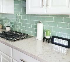 sea glass backsplash subway tile in green with white grout quartz white cabinets sea glass backsplash sea glass