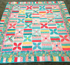 Craft Sew Create: June Bug Quilted! & The June Bug quilt for Jenessee has been quilted! I think Rolayne did a  beautiful job and so fast! It looks so bright and cozy! Adamdwight.com