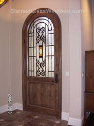 stained glass door insert made to mimic wrought iron