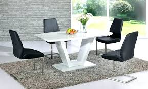 white dining table with black chairs high gloss and contemporary v pillar