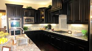 black marble kitchen counter top white plywood stained kitchen islands wooden stained kitchen cabinet metal pendant lamp stainless steel swing faucet