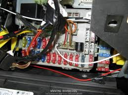 mg f tf how to fit heated seats to mg rover org forums the other wiring loom comes from the relay across the passenger footwell to the seats via the switches you can see the new cable exiting from the seatbelt