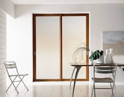 simple design of sliding interior doors in white color plus brown wooden frame