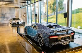 The latest of these models being a 3599 piece, 1:8 scale model of the iconic bugatti chiron. Bugatti Chiron And Full Size Lego Technic Bugatti Chiron On Disply Together