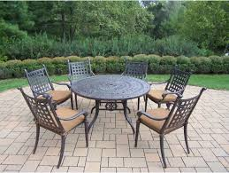 belmont aluminum 7 pc patio dining set includes 54 inch round table 6 stackable chairs