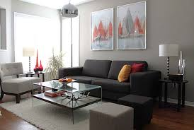 grey and white living room ideas brown varnished wood end table shelf ceramic table lamp glass candle holder wood fl sectional rugs