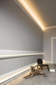 cool wall embellishment concept featuring calabasas moldings as chair rail above the baseboard and as baseboard lighting