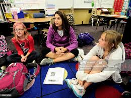 Lily Pate, left and Madeline Smith listen to teacher Mishel Reilly ...
