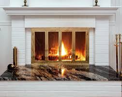 wood fireplace doors burning with blower stove door glass