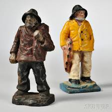 two paint decorated cast iron old salt doorstops