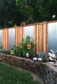 corrugated metal and wood privacy fence for a simple modenr look