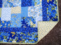 Sew Cook and Travel: Summer Breeze 2 Quilt Finished & It's backed with Summer Breeze yellow with little blue flowers, quilted  with a loose meander and bound with Summer Breeze light green. Adamdwight.com