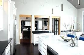 white sparkle quartz for kitchens island with stainless steel how are granite attached countertops