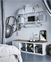 home gym furniture. Workout Equipment Is Stored On The Wall Of A Bedroom Hooks And Shelves. Home Gym Furniture