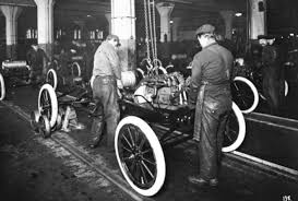henry ford cars 1920. workers install the engine in a ford model t henry cars 1920