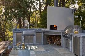 view in gallery the stainless steel appliances and the minimalist pizza oven design