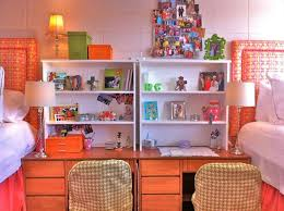 a small shelf set on top of your desk is a great way to use vertical space efficiently you could also divide the room for privacy by putting desks back to