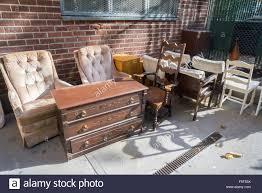 An assortment of furniture from a vacated apartment awaits bulk