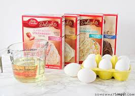 boxes of cake mix a cup of vegetable oil and eight eggs these are