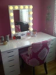 furniture rectangle white wooden makeup vanity with drawers and glass top added by pink fabric
